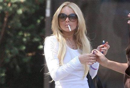 Lindsay Lohan smoking a cigarette (or weed)